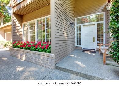 Large brown house front door.