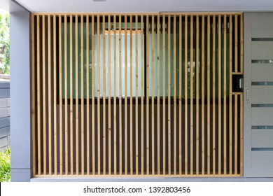 Large brown wooden battens installed with windows for blinds and sunscreen protection.