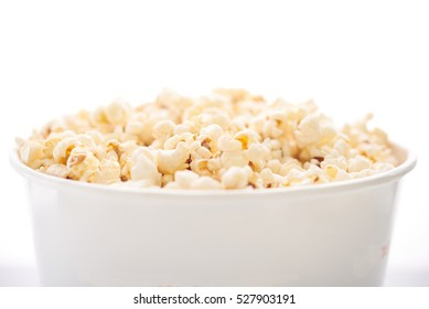 a large bucket of popcorn on a white background