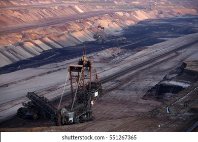 A large bucket wheel excavator in a lignite (brown-coal) mine during sunset, Germany