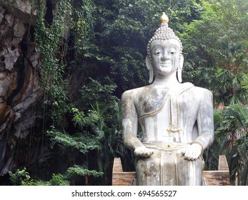 Large Buddha statue by the mountain at Wat Tham Khao Prathun, Khao Noi, Khao Chamao, Rayong, Thailand.