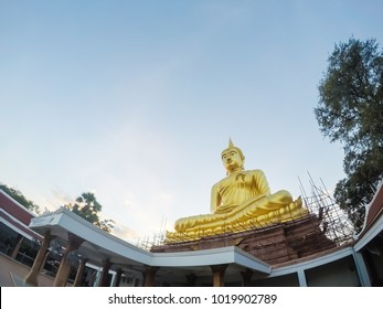 Large buddha statue in the temple of Thailand.