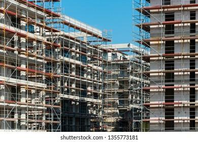 A large building construction site with cranes