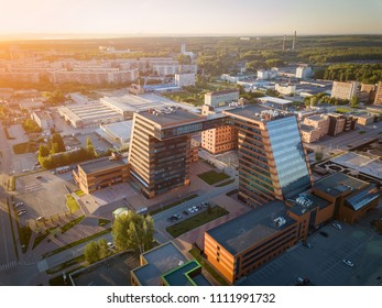 A large building with laboratories and innovative projects, inventions of a technical nature in the Technopark of the Novosibirsk Academic Township in a sunny day Aerial view