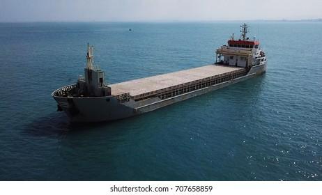 Large bulk carrier general cargo ship sailing / docking in open ocean