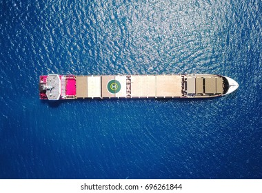 Large bulk carrier ship sailing / docking on open ocean