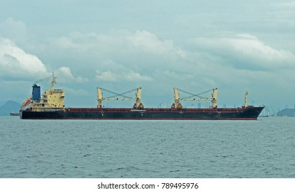 Large bulk carrier vessel used to carry everything from gain to minerals.  This photo was taken off of Panama City which can be seen in the background