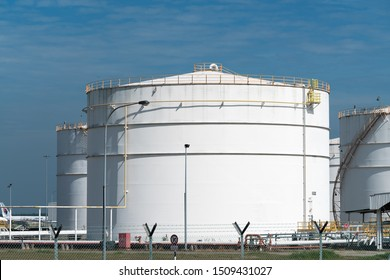 Large bulk storage tank for Airplane fuel jet A-1 against blue skies