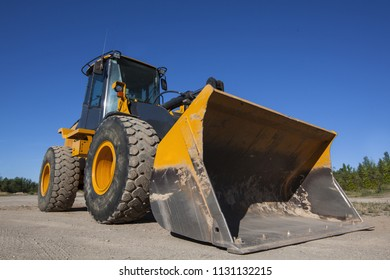 A large bull dozer, shot from a low angle.
