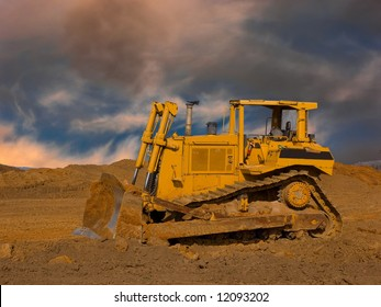Large bulldozer with a dramatic sky
