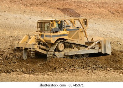 A large bulldozer working the grade for a new road and freeway interchange near Roseburg Oregon