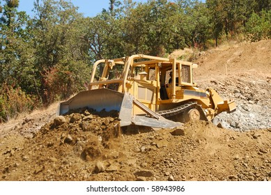 Large Bulldozer working a rock hill on a new business  project in Roseburg Oregon
