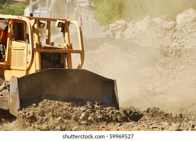 Large Bulldozer working a rock outcrop on a new business development project in Roseburg Oregon