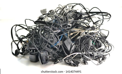 A large bundle of used multi-colored electronic cords and cables to be recycled for copper, brass, and other valuable metals.