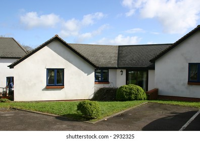 large bungalow in a small village setting