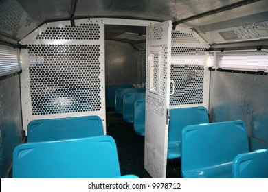 Large bus used by police to transport prisoners for public safety