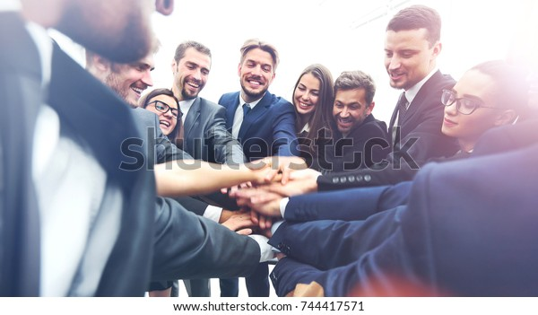 Large business team showing unity with their hands together