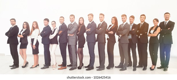 large business team standing arms crossed in front