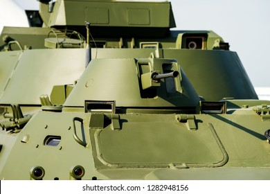 Large caliber machine gun with a rotary turret on the tank closeup