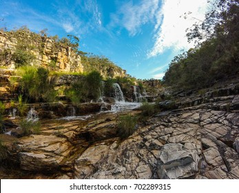 Large canyon with a small river running across the rocks at Serra da Canastra region in Brazil.