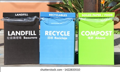 Large Cardboard boxes for separating trash. Marked for Landfill, Recycling and compost in bright colors. Labeled in English, Spanish and Chinese, Common languages spoken in San Francisco, California