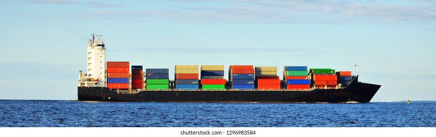 Large cargo container ship sailing in the Baltic sea. Freight transportation, logistics, global communications, economy, commerce, industry, supply, environment