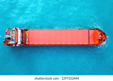 Large Cargo ship anchored at sea - Aerial image.