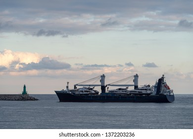 Large cargo ship entering the port of Imperia, Italy