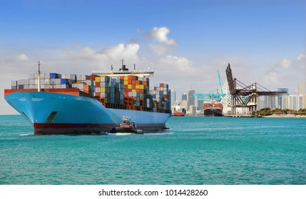 Large cargo ship with many shipping containers sailing from port