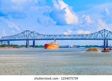 Large cargo ship navigating the Mississippi River near New Orleans, Louisiana.