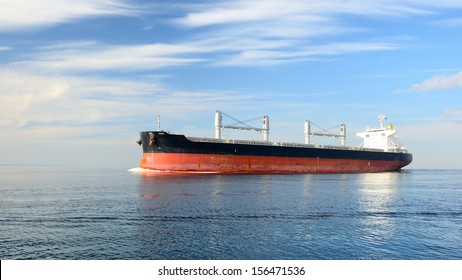 Large cargo ship sailing in still water
