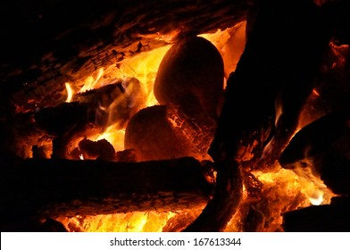 A large ceremonial fire made with oak logs is used to heat river stones for sweat lodge.