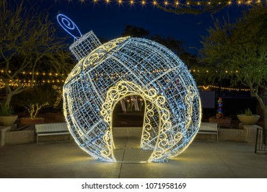 A large Christmas decoration (a sculpture of a tree ornament) in Old Town Scottsdale Arizona photoraphed at night.
