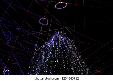 a large Christmas tree adorned with Christmas lights at the Advent in Ptuj and the goddess in ornaments in the form of lines and circles.