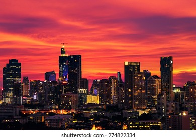 Large cities with tall buildings at night. The sky is red