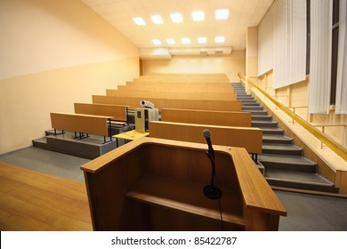 Large classroom, university lecture hall; view from lectern with microphone