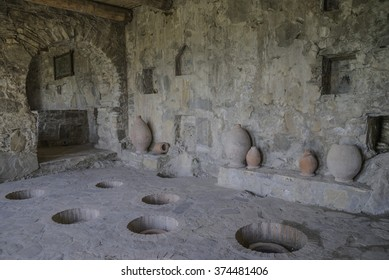 Large clay vessels for holding wine called kvevri buried underground in Kakheti region, Georgia.