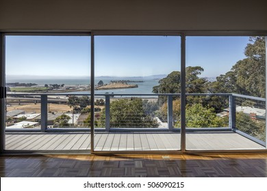 Large clean glass sliding doors with bay view.