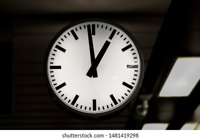 Large clock on the train station. Railway station clock hanging.