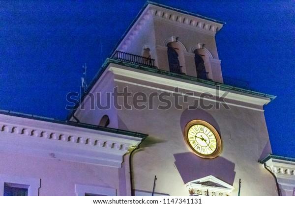 large clock of clock tower at night