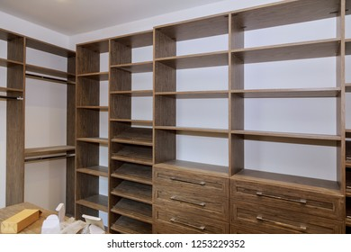 Large with in closet with many shelves and drawers.