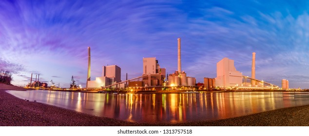 Large coal power plant located directly on the Rhine in Mannheim