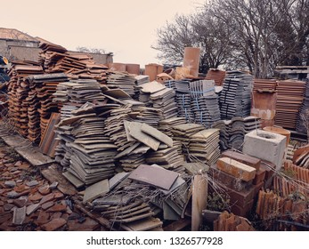 A large collection of different roof tiles at a salvage yard in the UK.