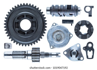 A large collection of metal engine components isolated on a white background.