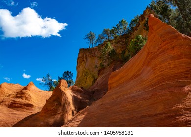 Large colorful ochre deposits, located in Roussillon, small Provensal town in  Natural Regional Park of Luberon, South of France, pigment for paint