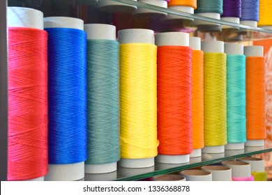 Large colorful polypropylene thread set in rainbow mood. Multicolor bobbin thread. Polypropylene multifilament yarns. Set of sewing thread coils, miscellaneous colours.