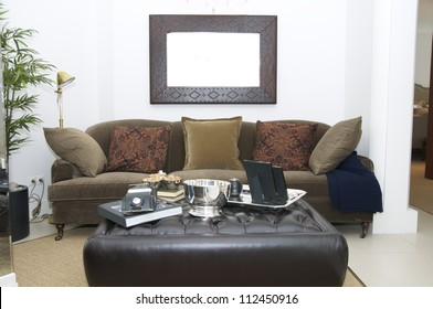 a large comfortable living room with lots of lights
