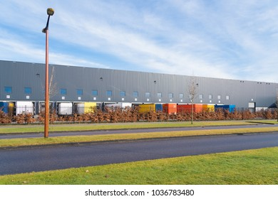 large commercial warehouse with trailers in front