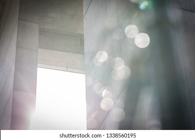 large concrete building with blurry fence moody background