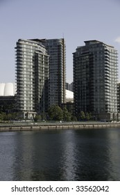 Large condo towers by the sea side on a sunny day.Vancouver, British Columbia